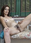 Anika strips nude on her outdoor patio