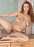 Cecelia Hart strips nude on her kitchen counter