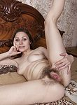 Sharon Rosie masturbates with a dildo in bed