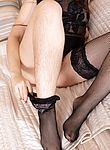 Vita slides off her black lingerie in bed