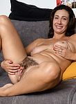Gadget strips nude to masturbate on her sofa