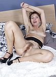 Dina masturbates in bed with her dildo